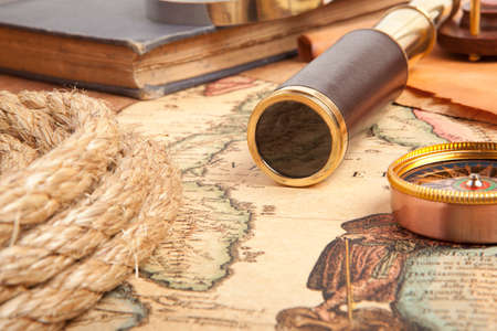 antique map: Vintage brass telescope on old antique map