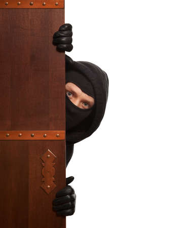 scammer: Ninja. Robber hiding behind a wooden doors with space for text