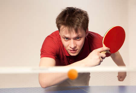Young man playing table tennis Zdjęcie Seryjne