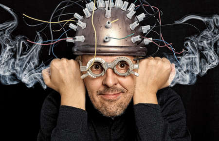 Crazy inventor with helmet for brain research