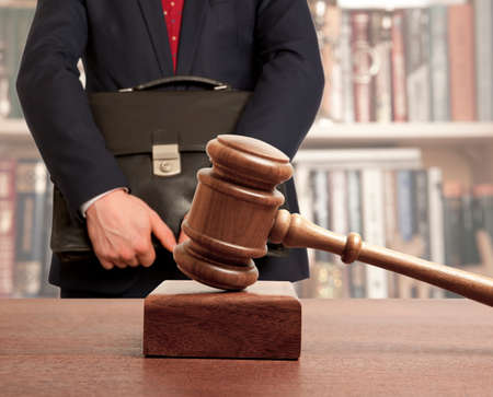 briefcase: Caucasian lawyer in court. Law concept Stock Photo