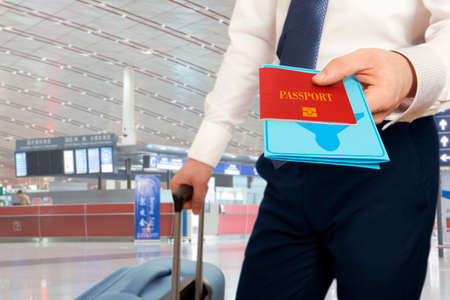 custom: Passport control. Traveling businessman handing passport and ticket