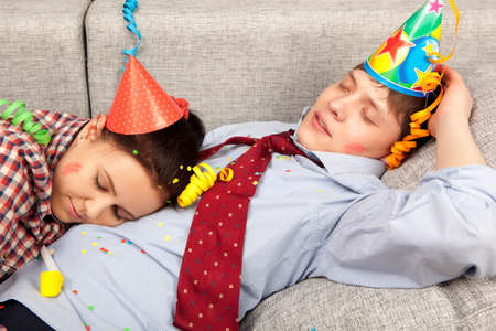 party hat: Sleeping couple in party hats at home