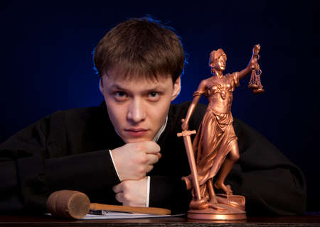 magistrate: Judge. Male judge in a courtroom striking the gavel