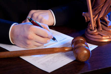 counsel: Judge. Male judge in a courtroom striking the gavel