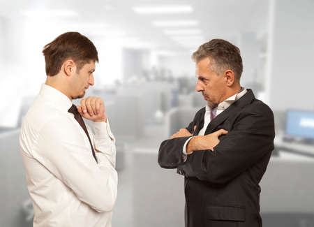 angry businessman: Business competition, conflict concept. Two businessman are trying to come to an agreement