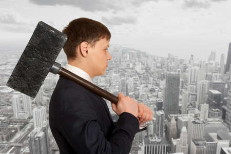 aggression: Business aggression. Determined businessman with hammer in hands. Stock Photo