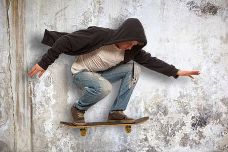 hip hop style: Skateboarder doing trick in mid air Stock Photo
