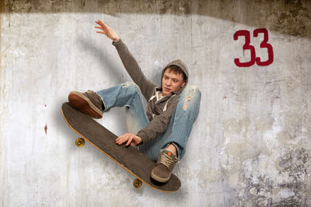 airborn: Skateboarder doing trick in mid air Stock Photo