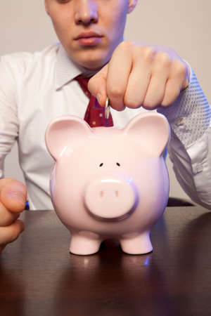 coin bank: Businessman with pink piggy bank and coin