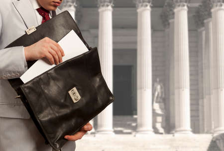 councilor: The lawyer with a briefcase is on against the courthouse Stock Photo