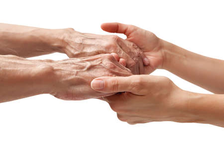 old hand: Hands of an elderly man holding the hand of a younger woman, isolated white background