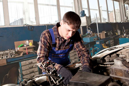 auto repair: Car mechanic working in auto repair service station Stock Photo