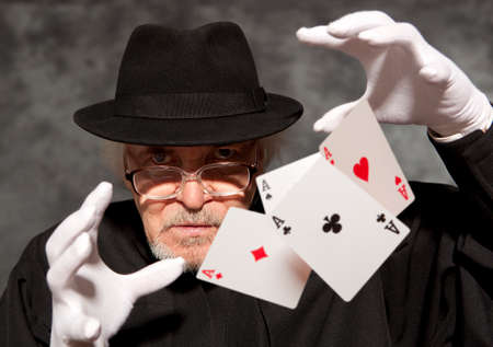 abracadabra: Magician show with playing cards. On grey background