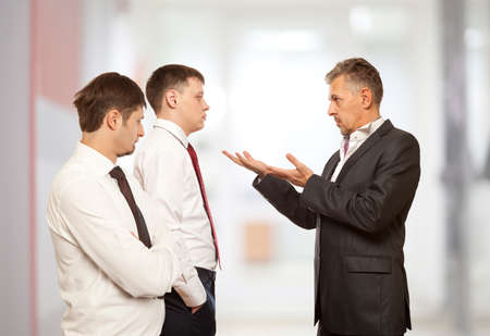 deny: Business conflict concept. Three businessman are trying to come to an agreement