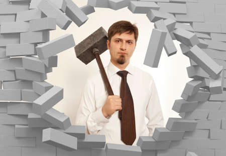 destroy: Determined businessman with hammer in hands Stock Photo