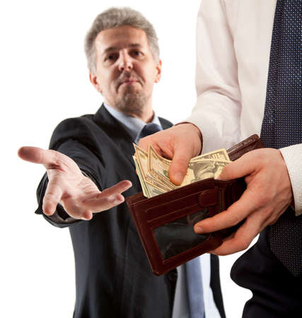 venal: Businessman taking bribe over white background.  Business concept