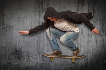 mid air: Skateboarder doing trick in mid air Stock Photo