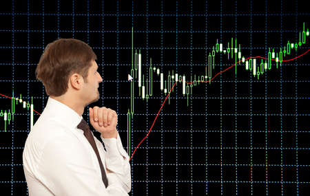 trader: Businessman stock trader looking at monitors