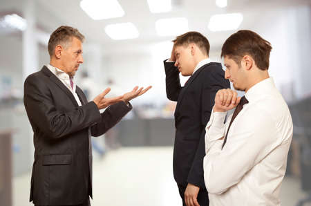 Business conflict concept. Three businessman are trying to come to an agreement