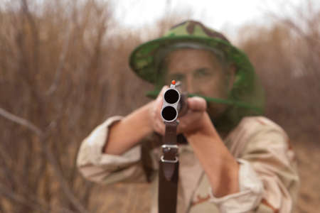 hunting rifle: Hunter in camouflage clothes ready to hunt with hunting rifle