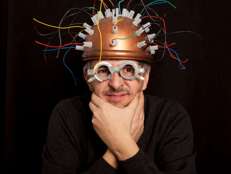inventor: Cheerful crazy inventor helmet for brain research Stock Photo