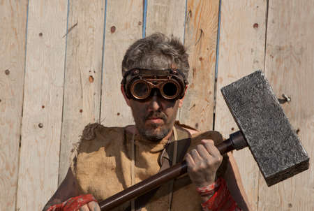 sledge hammer: Steampunk man wearing glasses with sledge hammer Stock Photo