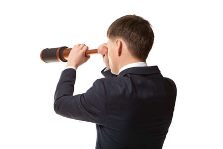 trailblazer: Business concept. Businessman looks through a telescope isolated on white