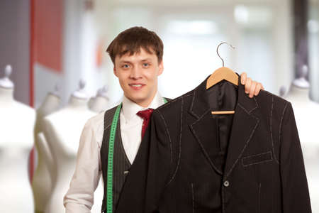 tailored: Taylor holds a handmade mans suit