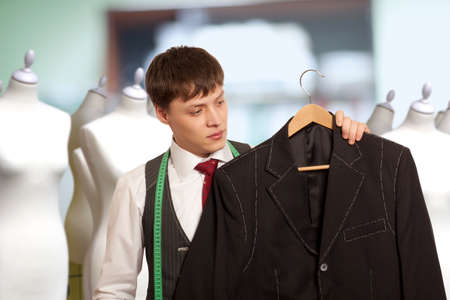 bespoke: Taylor holds a handmade mans suit