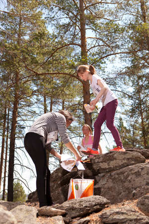 annually: RUSSIA, ULAN-UDE - MAY 22, 2016: Russian Azimut - 2016. Orienteering competition is held annually in the Buryatia region. People at at control point at orienteering course.