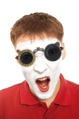 evil clown: Close-up portrait of a male evil mime with mechanical steampunk glasses. Isolated over white Stock Photo
