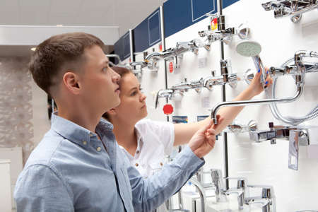Couple shopping for bathroom equipment in hardware store, shop for construction Stockfoto