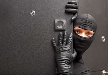 felon: Ninja. Robber hiding behind a door with space for text