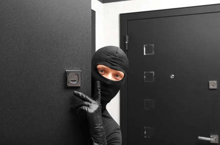 scammer: Ninja. Robber hiding behind a door with space for text