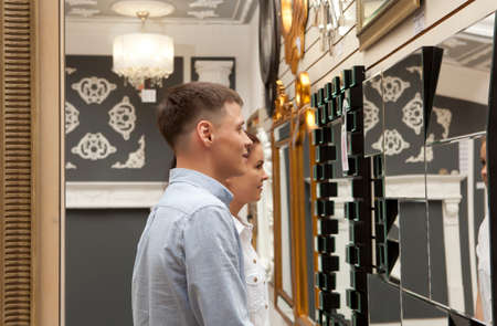 sale shop: Woman and man shopping  in home decoration store looking mirror