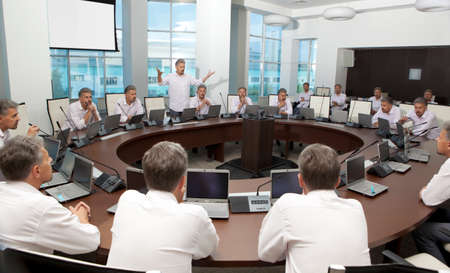 Meeting and discussion briefing. Business meeting, conference and meeting room, business presentation, office teamwork, team corporate, workplace discussing Stock Photo