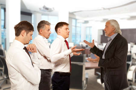 cheater: Business conflict concept. Four businessman are trying to come to an agreement Stock Photo