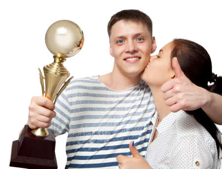 isolated man: Man holding up a gold trophy cup as a winner in a competition isolated on white Stock Photo