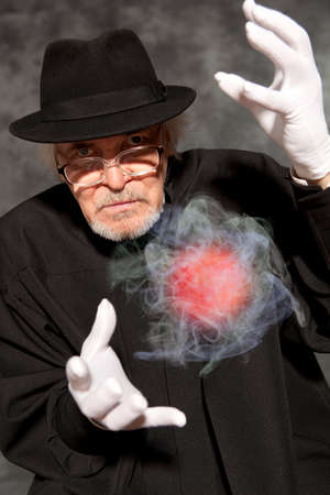 conjuring: Magician in top hat showing trick. Magic, performance, circus, show concept