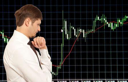 stock trader: Businessman stock trader looking at monitors