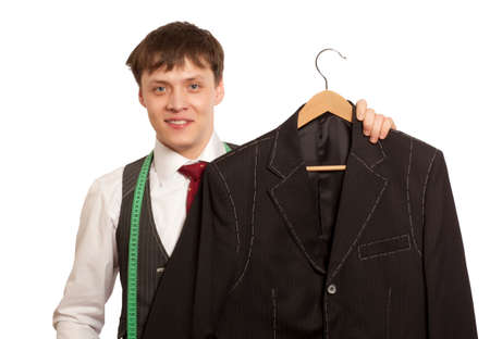 tailored: Taylor holds a handmade mans suit isolated on a white background Stock Photo