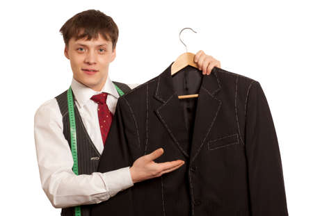 customer tailor: Taylor holds a handmade mans suit isolated on a white background Stock Photo