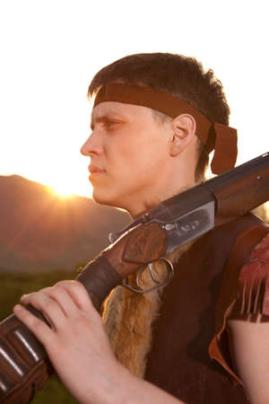 vintage rifle: Hunter in vintage clothes ready to hunt with hunting rifle