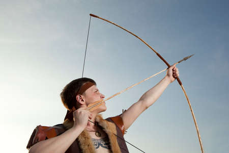 robin hood: Robin Hood. Young archer in vintage clothes with arrow and long bow Stock Photo