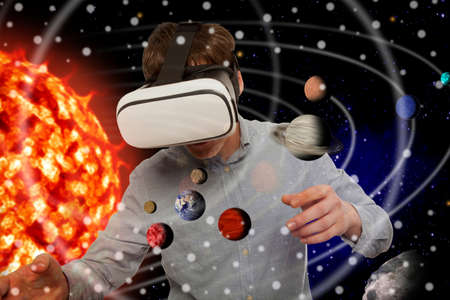 optical people person planet: Young man wearing virtual reality glasses