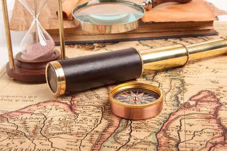 monocular: Vintage brass telescope on old antique map