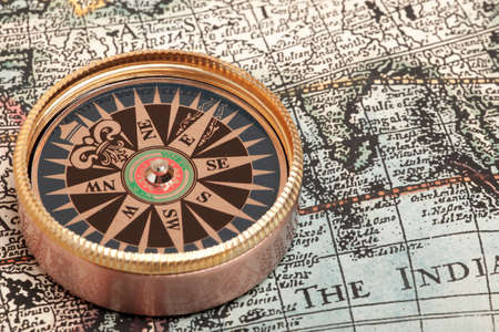 magnetic north: Old compass on vintage retro map