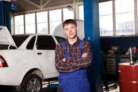 auto repair: Men Mechanic. Auto repair service.
