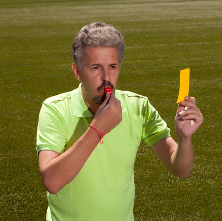 whistling: People, sport and soccer concept - man referee whistling pointing Stock Photo